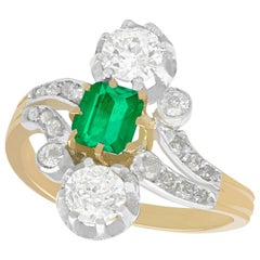 Antique 1880s 1.12 Carat Diamond and Emerald Yellow Gold Silver Set Twist Ring