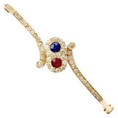 Antique 1890s Ruby and Sapphire 1.50 Carat Diamond and Yellow Gold Bangle