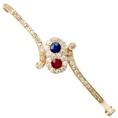 Antique 1890s Ruby and Sapphire 1.50 Carat Diamond Yellow Gold Bangle