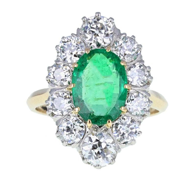 Edwardian Antique 18 Carat Gold Platinum Oval Emerald Diamond Navette Cluster Ring For Sale