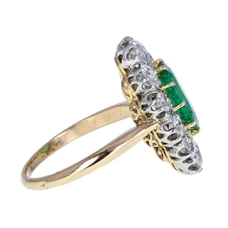 Oval Cut Antique 18 Carat Gold Platinum Oval Emerald Diamond Navette Cluster Ring For Sale
