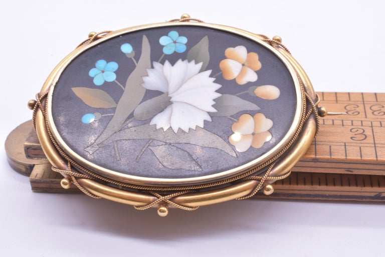 Victorian Antique 18 Carat Pietra-Dura Oval Flower Brooch with Intricate 18K Frame, c1860 For Sale