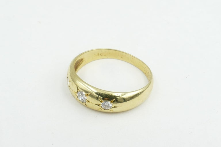 This very lovely old Gypsy Ring set in yellow Gold features 3 high level Diamonds. The  Colour is F-G & Clarity VS2 - SI1. The Diamond total weight is 0.22cts but they twinkle very brightly. The Band is polished, half round, reverse tapered to a