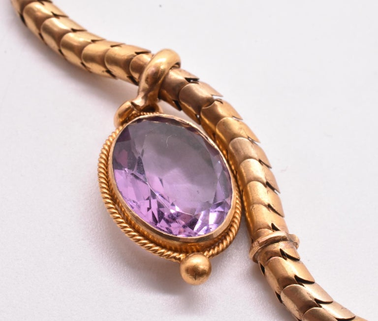 This romantic amethyst 18k necklace has a smooth and sultry snake chain that feels as good as it looks. The glittering large five amethysts fall symmetrically about the chain and always fall perfectly on the neck, with the central largest amethyst