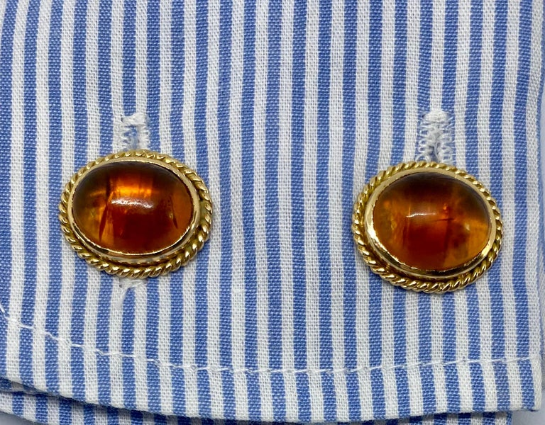 These beautiful, double-sided cufflinks feature four large amber cabochons set in solid 18K yellow gold with twisted rope detail. The amber is very high quality - bug-free and slightly cloudy from age - with a rich,