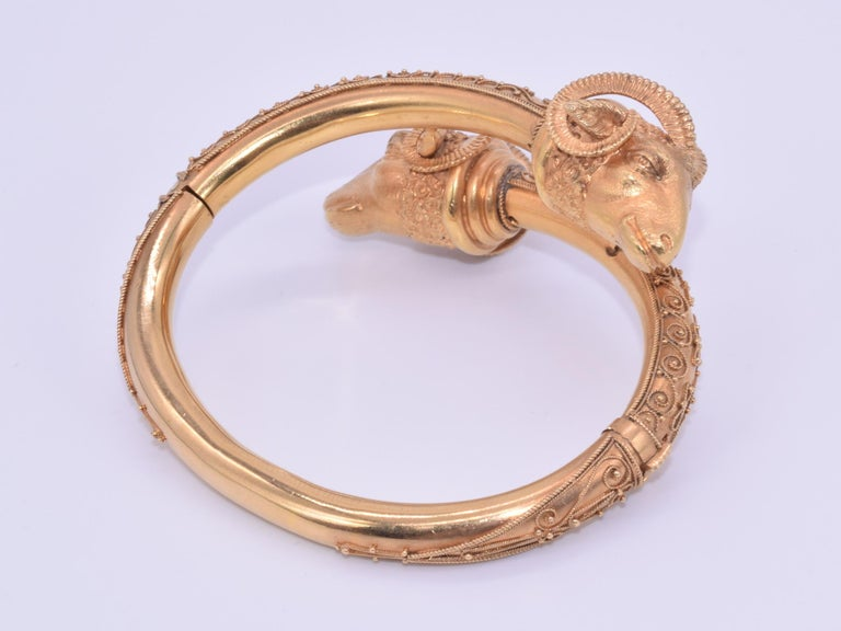 Antique 18 Karat Yellow Gold Rams Head Etruscan Revival Bangle, circa 1880s In Good Condition For Sale In New York, NY