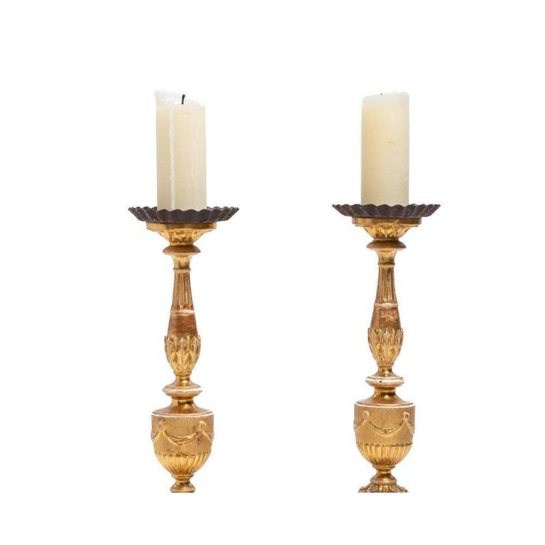 Antique 18th century continental neoclassical giltwood pricket candlesticks.