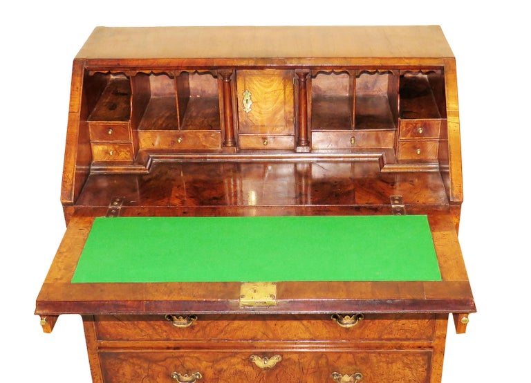A delightful early George II period walnut bureau of superb