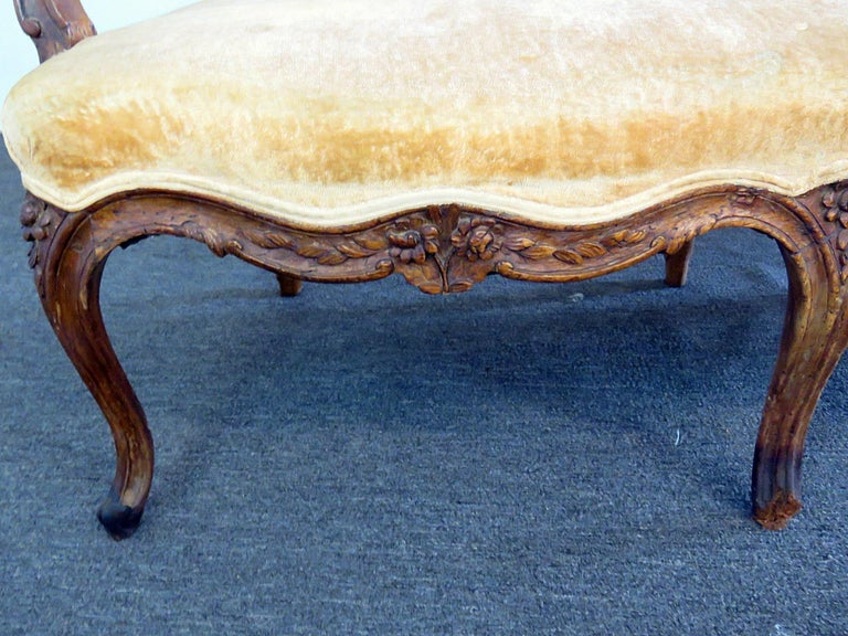 Antique 18th century carved walnut Louis XVI style sofa of large scale and of the period. This is a rare find and worthy of reupholstery and is a masterpiece.