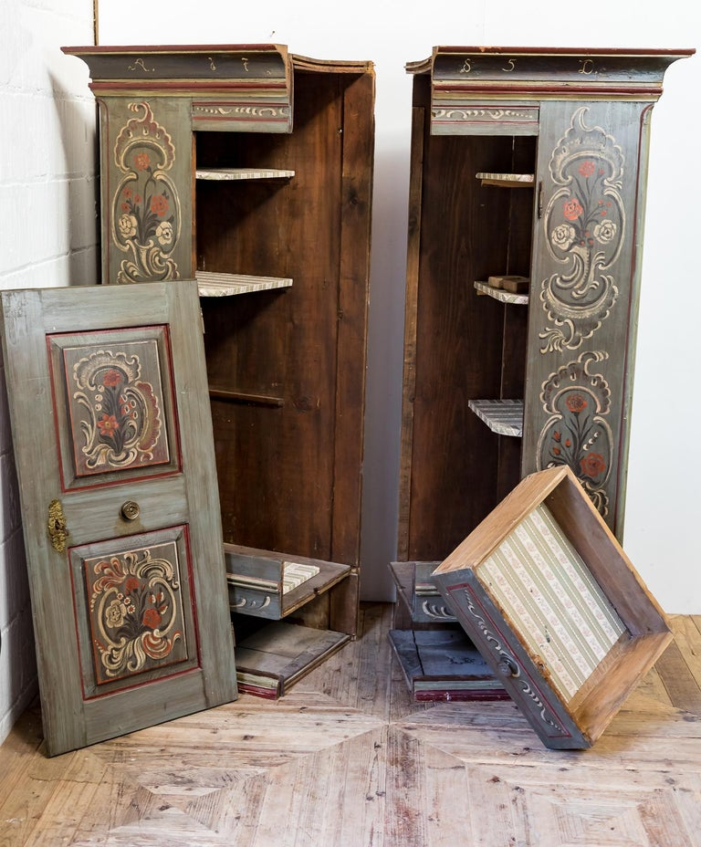 A wonderful hand painted Dutch marriage cupboard. In as found condition retaining all the original painted finish complete with the date 1785 to the top cornice. Of typical Dutch design splitting vertically down the middle to fit the tall narrow