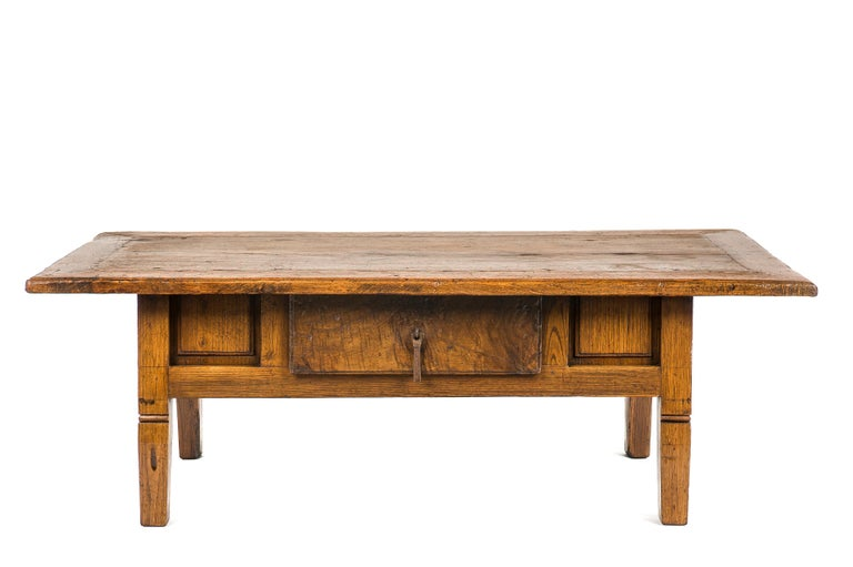 This beautiful honey color rustic coffee table or low table originates in Spain and dates circa 1780. The table has a beautiful paneled top with a central single piece of solid chestnut wood. The top has a beautiful patina with deep gloss and shows