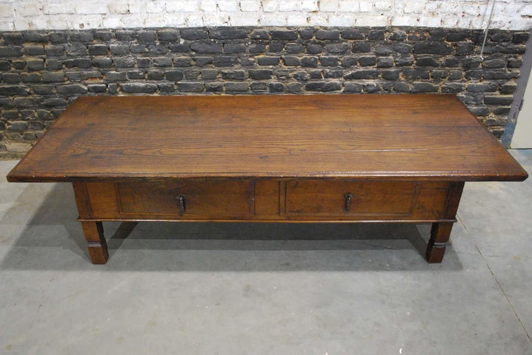 A beautiful rustic mid-18th century low table or coffee table that originates in Spain. The table is completely made in solid chestnut wood. The 1.18 inch thick top is made of two pieces of timber. The wood shows a remarkably fine wood grain