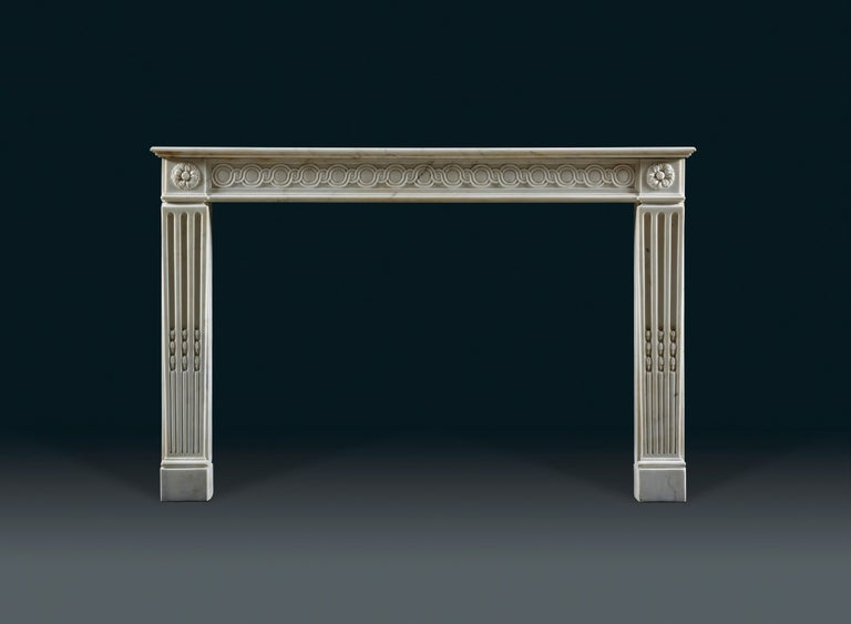 A rare and very high quality 18th century statuary marble French chimneypiece with rectangular moulded shelf above the frieze which is decorated with interlocking guilloche. The jambs of tapering pilaster form with cable stopped flutes and budding