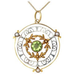 Antique 1900s Peridot and Pearl Yellow Gold and White Gold Pendant