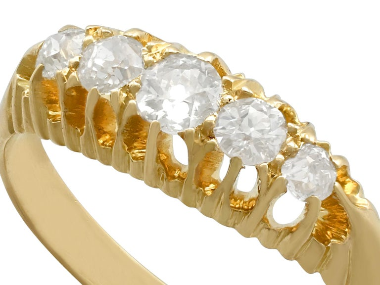 A fine and impressive antique 0.56 carat diamond and 18 karat yellow gold five stone dress ring; part of our diverse antique jewelry and estate jewelry collections.  This fine and impressive antique Edwardian diamond ring has been crafted in 18k