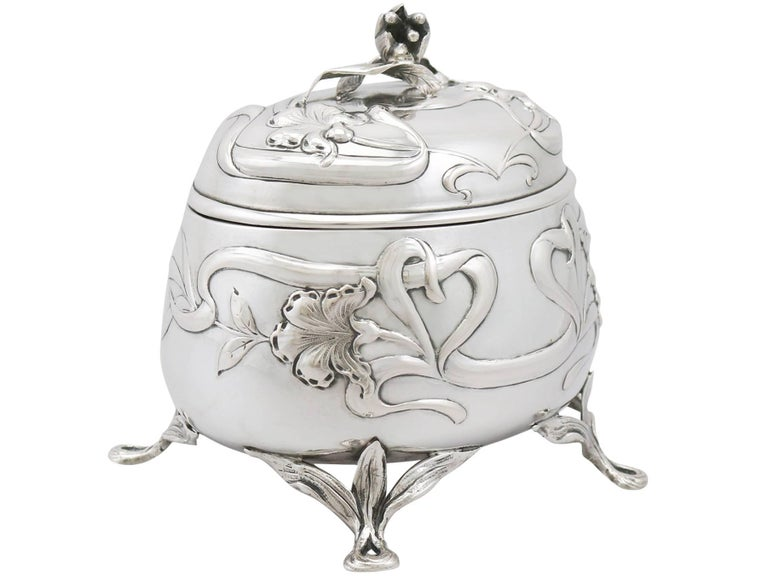 An exceptional, fine and impressive antique Austro-Hungarian 800 standard silver tea caddy in the Art Nouveau style; an addition to our silver teaware collection.  This exceptional Austro-Hungarian silver tea caddy has an oval rounded form.  The