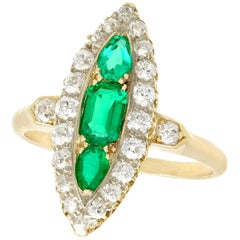 Antique 1910s Emerald and 1.38 Carat Diamond Yellow Gold Marquise Ring