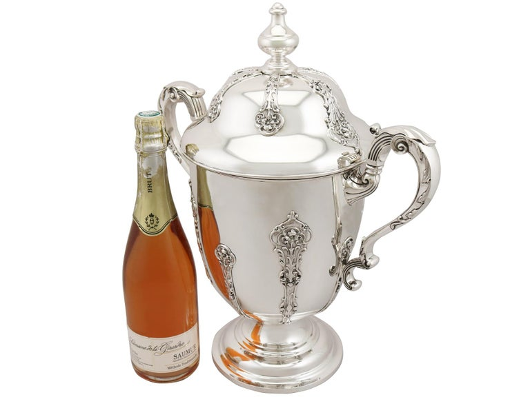 A magnificent, fine and impressive, large antique George V English sterling silver presentation cup with cover made by goldsmiths and silversmiths Co Ltd; an addition to our presentation silverware collection.