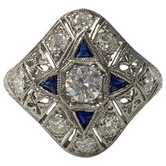 Antique 1920 White Old European Cut Diamond and Blue Sapphire Ring in Platinum