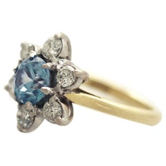 Antique 1920s 1.18 Carat Blue Zircon and Diamond Yellow Gold Cluster Ring