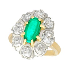 Antique 1920s 1.50 Carat Emerald and 2.85 Carat Diamond Yellow Gold Cluster Ring