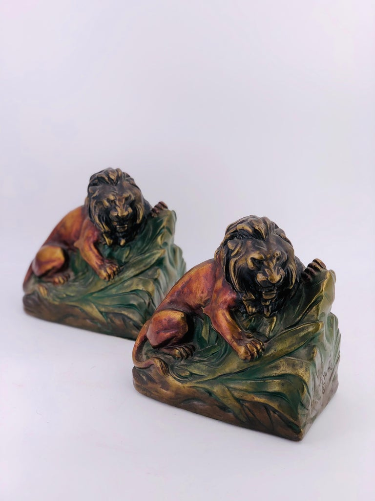 Rare 1920s armor bronze clad lion bookends pair vintage.  Very hard to find a pair of 1920s Armor bronze-clad lion bookends. These stunning bookends are in very good condition. Often, the bronze cladding gets cracked. We see no cracks on these.
