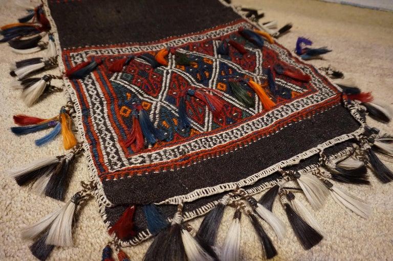 Sumak Antique 1920s Fine Turkish Saddle Bag Goat Hair with Decorative Tassels For Sale