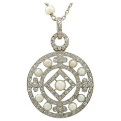 Antique 1920s Seed Pearl and 1.11 Carat Diamond and Platinum Pendant