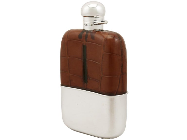 An exceptional, fine and impressive, large antique George V English sterling silver and crocodile skin mounted hip flask made by Mappin & Webb Ltd; part of our wine and drinks related silverware collection.  This exceptional antique George V