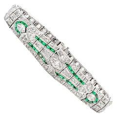 Antique 1930s Diamond Emerald Platinum Flor de Lis Filigree Bracelet