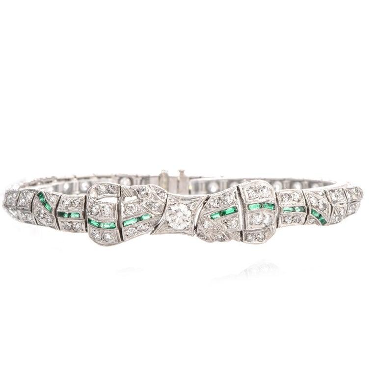 Art Deco Antique 1930s Diamond Emerald Platinum Ribbon and Bow Bracelet For Sale