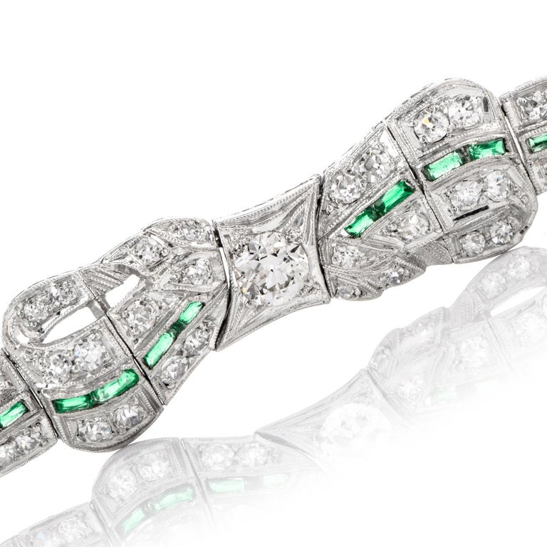 Antique 1930s Diamond Emerald Platinum Ribbon and Bow Bracelet In Excellent Condition For Sale In Miami, FL