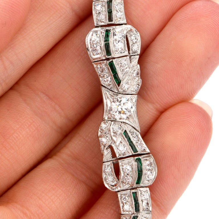Women's Antique 1930s Diamond Emerald Platinum Ribbon and Bow Bracelet For Sale