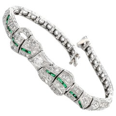 Antique 1930s Diamond Emerald Platinum Ribbon and Bow Bracelet