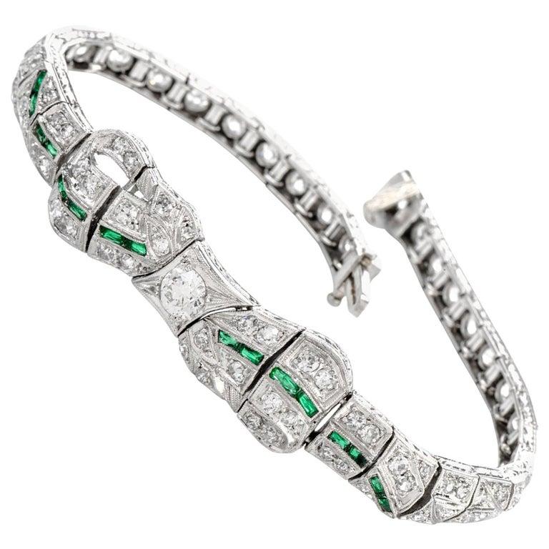 Antique 1930s Diamond Emerald Platinum Ribbon and Bow Bracelet For Sale