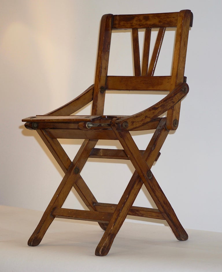 A charming model of a folding chair, entirely handmade in Italy in oak, 