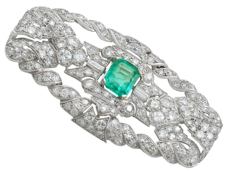 A stunning, fine and impressive 1.98 Ct emerald and 5.22 Ct diamond brooch in platinum; part of our authentic antique Art Deco jewelry/jewelry collection.  This stunning example of antique emerald and diamond brooch has been crafted in