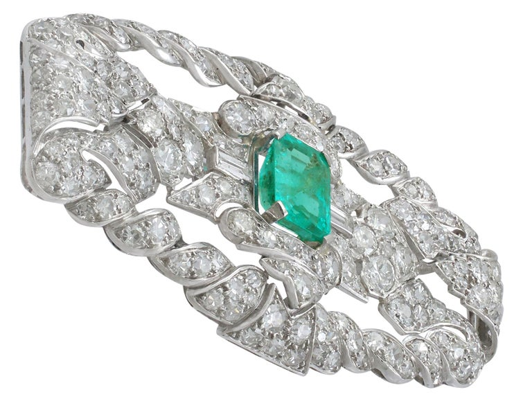 Art Deco Antique 1.98 Carat Emerald 5.22 Carat Diamond Platinum Brooch For Sale