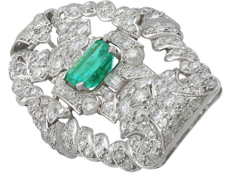 Emerald Cut Antique 1.98 Carat Emerald 5.22 Carat Diamond Platinum Brooch For Sale