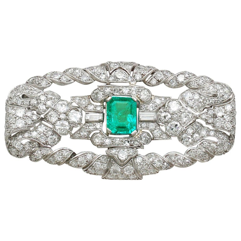 Antique 1.98 Carat Emerald 5.22 Carat Diamond Platinum Brooch For Sale