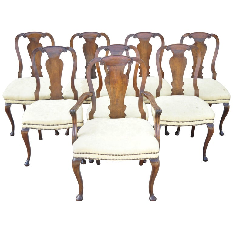 Antique 19th century English queen Anne burr walnut splat back dining chairs - set of 8. Set includes (7) side chairs, (1) armchair, remarkable aged patina, shapely queen Anne legs, solid wood frame, beautiful wood grain. Believed to be late