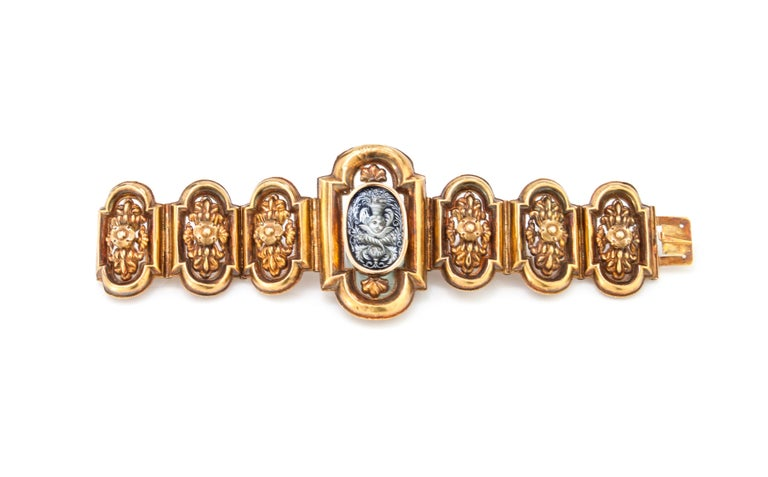 Antique 18kt yellow gold ladies bracelet, with enamel center depicting a putto. Handmade in Italy, Circa 1870's Tested positive for 18kt gold.  Dimensions - Weight : 28 grams Length x Width: 17 x 5.2 cm  Condition: Bracelet is has some age related