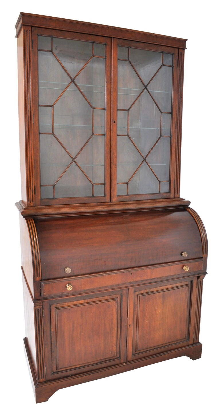 Fine antique 19th century american mahogany cylinder bookcase/secretary/desk, circa 1860. The bookcase having twin doors with astragal glazing and enclosing three shelves. The base having a cylinder roll top enclosing a fitted interior with drawers