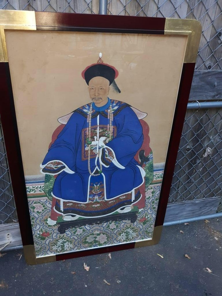 A large Chinese ancestral portrait watercolor on paper. China, Mid-19th century. Beautifully framed in a custom wood frame with gold leaf corners. Measures: 54 inches tall, 34 inches wide.