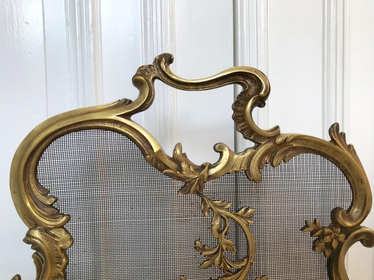 This Louis 15th style fire screen has amazing details and it is both marked and numbered.  If this beautifully handcrafted, 19th century firescreen is the right style to fit your fireplace and the size is correct for you as well then you could