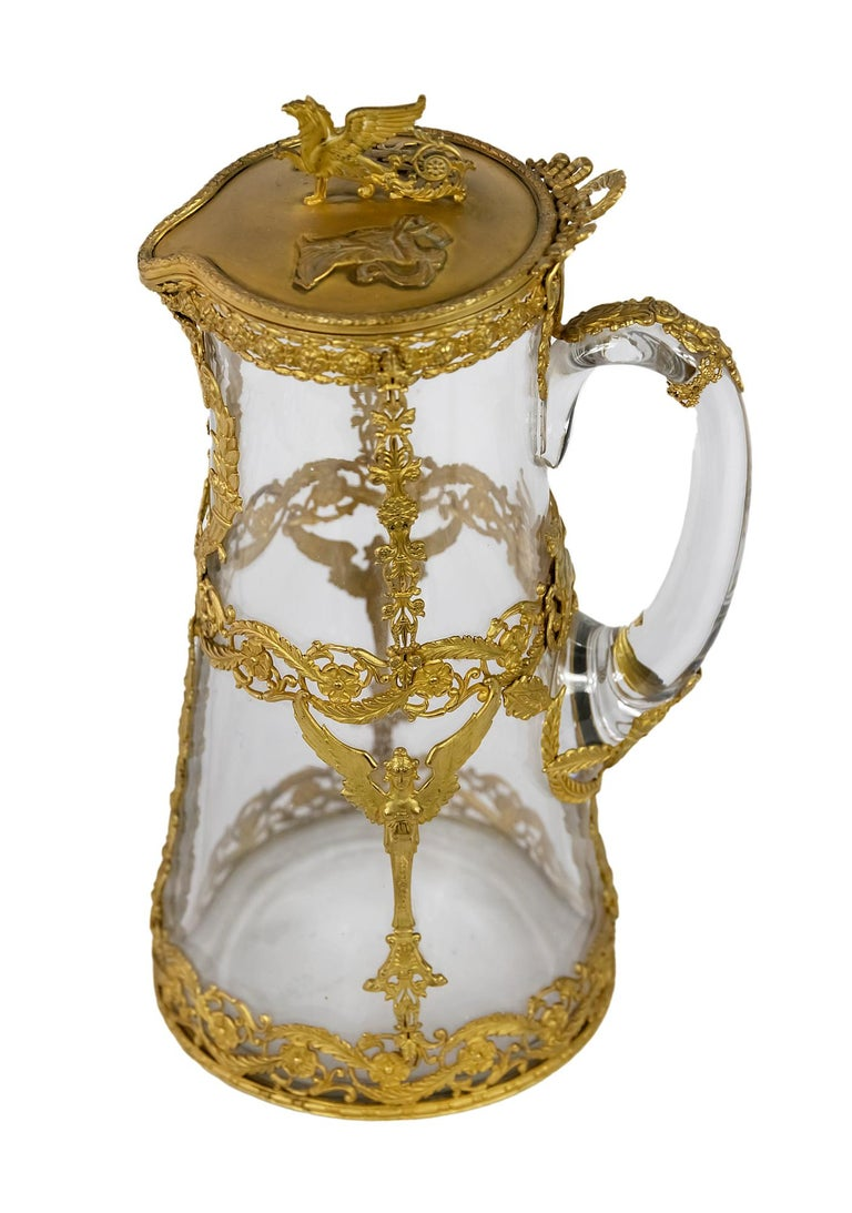 Antique 19th century French gilded bronze and glass jug/pitcher. The glass part is decorated with Empire style gilded bronze decor.