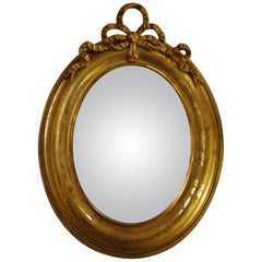 Antique 19th Century French Gold Leaf Gilt Convex Mirror with Ribbon Bow on Top
