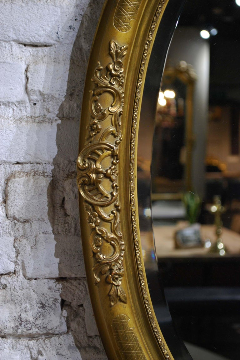 Gesso Antique 19th Century French Oval Gold Leaf Gilt Mirror with Faceted Glass For Sale