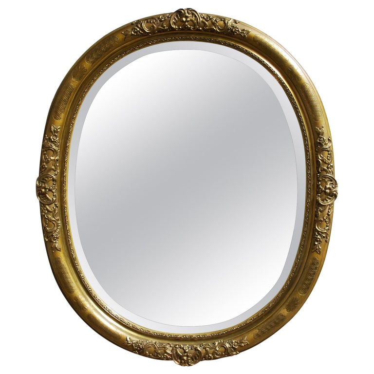 Antique 19th Century French Oval Gold Leaf Gilt Mirror with Faceted Glass For Sale