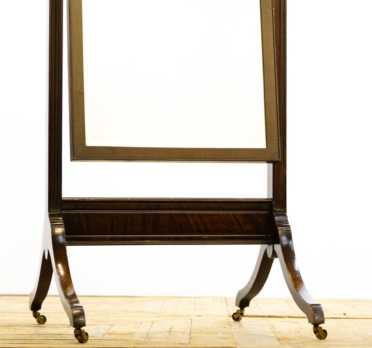 A lovely 19th century cheval mirror of small proportions.